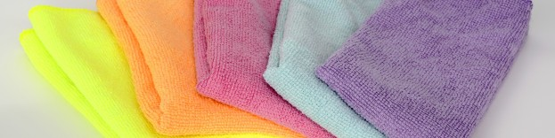 An image of five different coloured microfibre cloths used to clean stainless steel ovens