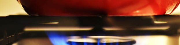 An image of a pan being heated up on a gas hob.