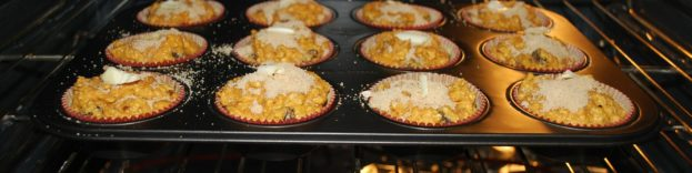image of muffins baking in an oven